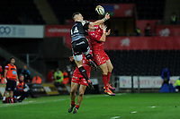 George North of Ospreys under pressure from Dan Jones of Scarlets during the Guinness Champions Cup play-off match between the Ospreys and Scarlets at the Liberty Stadium in Swansea, Wales, UK.  Saturday 18 May 2019