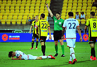 Wellington captain Andrew Durante is yellow carded during the A-League football match between Wellington Phoenix and Adelaide United at Westpac Stadium in Wellington, New Zealand on Saturday, 27 January 2018. Photo: Dave Lintott / lintottphoto.co.nz