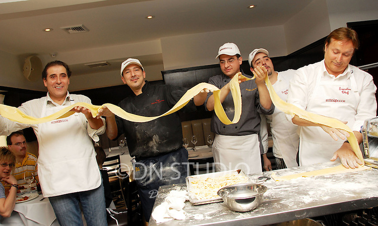 """(L-R) Manager of Bella Blu and Chef Nicola Gabrielle, Chef at Bella Blu Roberto Patriarca, Chef at Baraonda Giuseppe Mazzeo, Paolo Nozzoli and Owner, Proietti Restaurant Group and Chef Enrico Proietti Ciaobella Restaurant Brings """"The Art Of Pasta"""" To Children In Need. Owner and Chef Enrico Proietti and Executive Chef Floess show the children of the Ronald McDonald House of NY about the history of Italian food."""