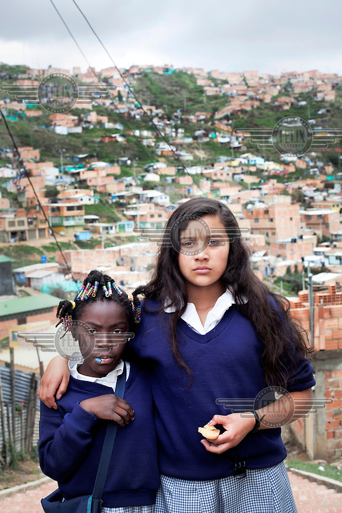 A portrait of two girls in the slum neighbourhood of Soacha, south of Bogota. Most of the people who live here are internally displaced (IDPs).This story by Mads Nissen was partly funded by a grant and when published it should be credited: Funding for this project was provided by the Manuel Rivera-Ortiz Foundation for International Photography.