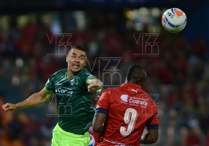 MEDELLIN - COLOMBIA - 13 - 03 - 2018: Juan Fernando Caicedo (Der.) jugador de Deportivo Independiente Medellin disputa el balón con Francisco Najera (Izq.) jugador de La Equidad, durante partido de la fecha 8 entre Deportivo Independiente Medellin y La Equidad, por la Liga Aguila I 2018, en el estadio Atanasio Girardot de la ciudad de Medellin. / Juan Fernando Caicedo (R) player of Deportivo Independiente Medellin fights for the ball with Francisco Najera (L) player of La Equidad, during a match for the 8th date between Deportivo Independiente Medellin and La Equidad, for the Liga Aguila I 2018 at the Atanasio Girardot stadium in Medellin city. Photos: VizzorImage  / Leon Monsalve / Cont.