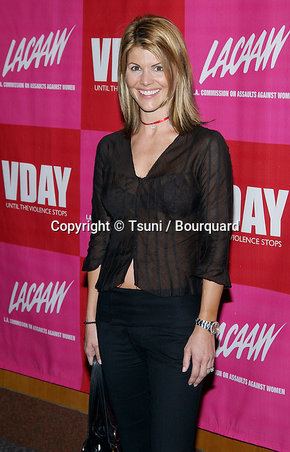 """Lori Laughlin arriving at the """" V DAY L.A. Until The Violence Stops """" at the Director Guild Of America Theatre In Los Angeles. February 24, 2003          -            LaughlinLori33.jpg"""