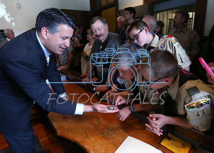Gov. Brian Sandoval shows off the first medallion minted in a ceremony marking the beginning of production of the third medallion in the four-part Sesquicentennial series, at the Nevada State Museum in Carson City, Nev., on Friday, May 30, 2014. <br /> Photo by Cathleen Allison