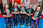 Ciara and Sinead Frampton, Isabel Shaw, Emily Keane and Catelynn Diggins of Blackbelt Martial Arts Academy in Tralee, won 12 of the 19 WMO World Championship medals held in Portugal last weekend that was won by the academy.