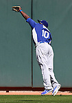 Dodgers outfielder Tony Gwynn Jr. makes a leaping catch in a Cactus League preseason game between the Dodgers and the A's in Scottsdale, Ariz., on Wednesday, March 7, 2012. The game ended 3-3..Photo by Cathleen Allison