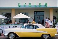 50s Scene with yellow car at Avalon, outdoor restaurant. Arch - Albert Anis, 1941. 700 Ocean Dr., M. Beach FL USA.