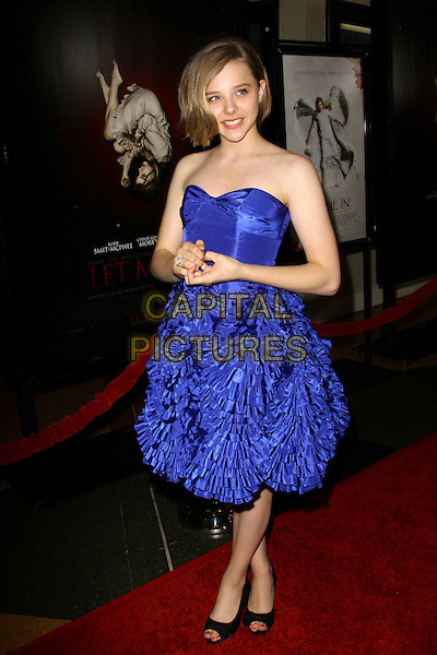 """CHLOE MORETZ.Los Angeles Premiere of """"Let Me In"""" held at The Bruin Theatre, Los Angeles, California, USA..September 27th, 2010.full length blue strapless dress frills layers layered ruffle.CAP/ADM/TC.©T. Conrad/AdMedia/Capital Pictures."""