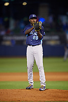 Corpus Christi Hooks relief pitcher Akeem Bostick (28) looks in for the sign during a game against the Tulsa Drillers on June 3, 2017 at ONEOK Field in Tulsa, Oklahoma.  Corpus Christi defeated Tulsa 5-3.  (Mike Janes/Four Seam Images)