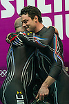 KRASNAYA POLYANA, RUSSIA  - JANUARY 17:<br /> Pilot Steven Holcomb, left, and brakeman Steven Langton, celebrate after competing in the men's two-man bobsled at Sanki Sliding Center during the 2014 Sochi Olympics Monday February 17, 2014. USA-1 with Steven Holcomb, of Park City, Utah, and Steve Langton, of Melrose, Mass., won the bronze medal with a time of 3:46.27.<br /> (Photo by Chris Detrick/The Salt Lake Tribune)