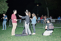 """A reporter interviews a rally attendee after entrepreneur and Democratic presidential candidate Andrew Yang spoke to a large crowd in Cambridge Common near Harvard Square in Cambridge, Massachusetts, on Mon., September 16, 2019. Yang's unlikely presidential bid is centered on his idea for a """"Freedom dividend,"""" which would give USD$1000 per month to every adult in the United States. After appearing in three Democratic party debates, Yang has risen in polls from longshot candidate to within the top 10."""