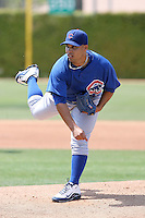 Juan Serrano of the Chicago Cubs plays in a minor league spring training game against the San Francisco Giants at the Cubs complex on March 29, 2011  in Mesa, Arizona. .Photo by:  Bill Mitchell/Four Seam Images.