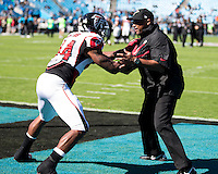 The Carolina Panthers defeated the Atlanta Falcons 34-10 in an inter-division rivalry played in Charlotte, NC at Bank of America Stadium.  Atlanta Falcons fullback Jason Snelling (44) warms up with a coach before the game