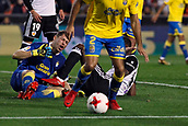 9th January 2018, Mestalla Stadium, Valencia, Spain; Copa del Rey football, round of 16, second leg, Valencia versus Las Palmas; Goalkeeper for Las Palmas Lizoain clashes with Geoffrey Kongdobia, midfielder for Valencia CF during the game