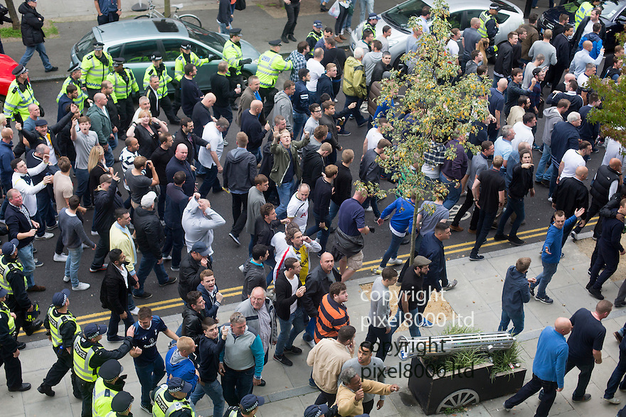 Pic shows: Arsenal v Spurs  North London Derby 28.9.14<br /> <br /> Spurs fans are corralled towards the away supporters entrance by police as they face the jeers of home fans.<br /> <br /> <br /> <br /> picture by Gavin Rodgers/ Pixel