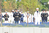 """Arlington, VA - September 11, 2008 -- One hundred eighty-four joint service troops stand ready to unveil the Pentagon Memorial Sept. 11, 2008, as the United States Air Force Band plays """"Who Are the Brave."""" The national memorial is the first to be dedicated to those killed at the Pentagon on Sept. 11, 2001. The site contains 184 inscribed memorial units honoring the 59 people aboard American Airlines Flight 77 and the 125 in the building who lost their lives that day. .Credit: Cherie Cullen - DoD via CNP"""