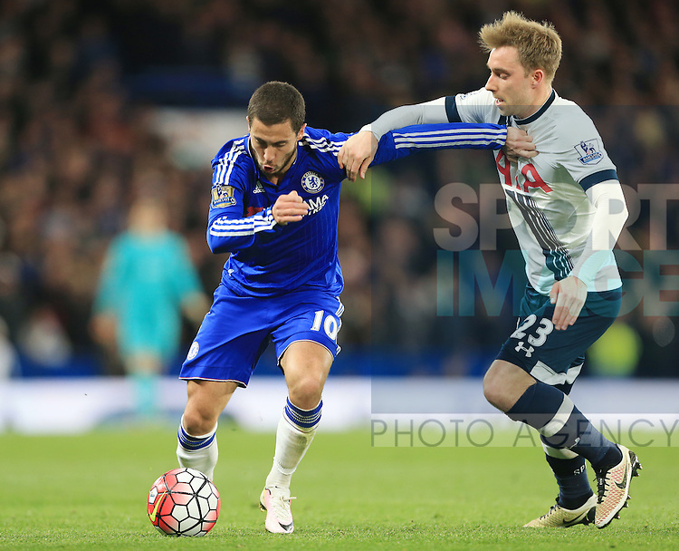 Chelsea's Eden Hazard tussles with Tottenham's Christian Eriksen during the Barclays Premier League match at Stamford Bridge Stadium.  Photo credit should read: David Klein/Sportimage