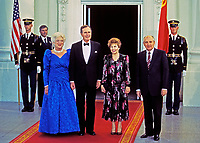 United States President George H.W. Bush, left center, and President Mikhail Gorbachev of the Union of Soviet Socialist Republics, right, pose for a group photo with their wives in front of the North Portico of the White House in Washington, DC prior to a state dinner  on Thursday, May 31, 1990.  From left to right: First lady Barbara Bush, President Bush, Raisa Gorbachev, and President Gorbachev.<br /> CAP/MPI/RS<br /> &copy;RS/MPI/Capital Pictures