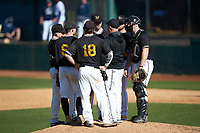 West Virginia State Yellow Jackets pitching coach Larry Vance has a meeting on the mound during the game against the Catawba Indians at Newman Park on February 9, 2020 in Salisbury, North Carolina. The Indians defeated the Yellow Jackets 15-9 in game one of a doubleheader.  (Brian Westerholt/Four Seam Images)