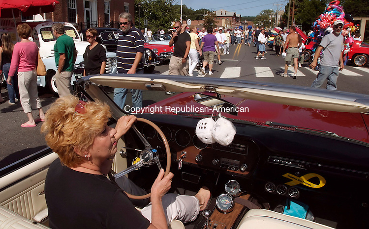 THOMASTON, CT - 11 September 2005 -091105JS02-- Alice Capaldo of Terryville, drives her son's 1966 Pontiac GTO into position during the 14th annual Summer Cruz, sponsored by the Thomaston Police Explorers, Sunday on Main Street in Thomaston. Marty Capaldo of Thomaston purchased the GTO on September 11, 2001. --Jim Shannon / Republican-American  -- Marty Capaldo; Alice Capaldo; Terryville; Thomaston Police Explorers are CQ