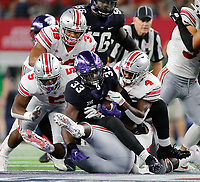 Ohio State Buckeyes safety Jordan Fuller (4) and Ohio State Buckeyes linebacker Baron Browning (5) tackle TCU Horned Frogs running back Sewo Olonilua (33) during the 2nd quarter of their game at AT&T Stadium at Arlington, Texas on September 15, 2018.  [Kyle Robertson/Dispatch]