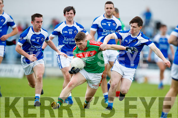 Tommy Begley and Dave Murphy Kerins O'Rahillys in action against Noel Duggan Kilcummin Senior Football Championship Relegation Playoff in Austin Stack Park on Sunday