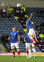 Emilson Cribari heading as Lee McCulloch watches in the Rangers v Queen of the South Quarter Final match in the Ramsdens Cup played at Ibrox Stadium, Glasgow on 18.9.12.
