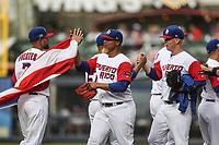 Con salvamento del pitcher Miguel Mejia Puerto Rico se lleva la victoria 9 carreras por 3 de italia, durante el partido entre Italia vs Puerto Rico, World Baseball Classic en estadio Charros de Jalisco en Guadalajara, Mexico. Marzo 12, 2017. (AP Photo/Luis Gutierrez)