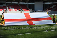 The ballgirls unveil the English national flag before the game begins. The UEFA Womens U19 Championships at Parc y Scarlets, Monday 19th August 2013. All images are the copyright of Jeff Thomas Photography-www.jaypics.photoshelter.com-07837 386244-Any use of images must be authorised by the copyright owner.