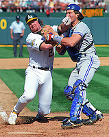 Baseball: Oakland Athletics Mark McGwire and Toronto Blue Jays Pat Borders in action during the ALCS. Oakland, CA 10/8/1992 MANDATORY CREDIT: Brad Mangin
