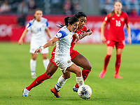 CARSON, CA - FEBRUARY 07: Lixy Rodriguez #12 of Costa Rica fights for the ball with Ashley Lawerance #10 of Canada during a game between Canada and Costa Rica at Dignity Health Sports Park on February 07, 2020 in Carson, California.