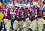 Florida State quarterback Jameis Winston calls a play in the huddle during the first half of an NCAA college football game against Boston College in Tallahassee, Fla., Saturday, Nov. 22, 2014.  Florida State defeated Boston College 20-17.  (AP Photo/Mark Wallheiser)