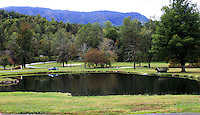 Stock photo: A small lake and meadow surrounded by the hills of the great smoky mountain.