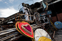A dismantled carnival float abandoned on the work yard behind the Samba school workshops in Rio de Janeiro, Brazil, 15 February 2012. Most of the large carnival floats, colorful designs and fancy costumes are dismantled, cut into pieces or simply thrown into garbage right after the last day of the Carnival. The low-tech materials as fiberglass, plastic or polystyrene, which most of the of the carnival floats and statues are made of, are stocked in the warehouses to be recycled and used in the future parades. However, there is no use for some of the statues so they slowly fall apart into pieces forming a ?Carnival cemetery? in the industrial yards around the port of Rio de Janeiro.