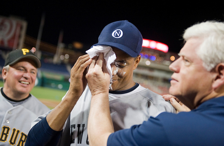 UNITED STATES - JULY 14:  Winning pitcher Rep. Cedric Richmond, D-La., has a shaving cream pie wiped of his face by Democratic Conference Chair John Larson, D-Conn., as Democratic team manager Mike Doyle, D-Pa., looks on, after the 50th Annual Congressional Baseball Game at Nationals Park.  The Democrats prevailed over the Republicans by the score of 8-2.  Rep. Bruce Braley, D-Iowa, congratulated hi with the pie. (Photo By Tom Williams/Roll Call)
