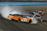 Apr 20, 2007; Avondale, AZ, USA; Nascar Busch Series driver Johnny Sauter (28) spins after contact with David Ragan (6) during the Bashas Supermarkets 200 at Phoenix International Raceway. Mandatory Credit: Mark J. Rebilas