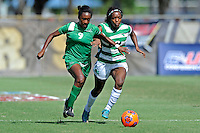 8 November 2015:  Marshall Forward Sydney Arnold (9) advances the ball with North Texas Forward Amber Haggerty (12) in pursuit in the first half as the University of North Texas Mean Green defeated the Marshall University Thundering Herd, 1-0, in the Conference USA championship game at University Park Stadium in Miami, Florida.