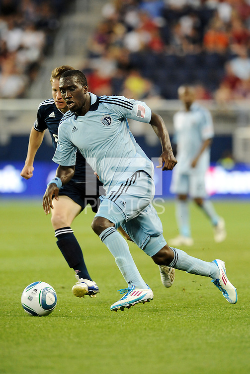 C.J Sapong (17) Sporting KC forward heads for the goal... Sporting KC defeated Vancouver Whitecaps 2-1 at LIVESTRONG Sporting Park, Kansas City, Kansas.