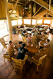 INDONESIA, Mentawai Islands, Kandui Resort,  people having breakfast in a dining lodge