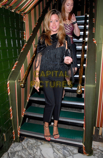 REBECCA LOOS.At the Flora Kung London Fashion Week Party,.Annabel's, Berkeley Square, London, England,.September 18th 2006..full length black top trousers shawl bag strappy shoes sandals stairs.Ref: FIN.www.capitalpictures.com.sales@capitalpictures.com.©Steve Finn/Capital Pictures.
