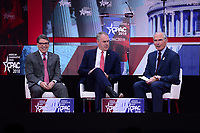 National Harbor, MD - February 23, 2018: Secretary of Energy Rick Perry and Interior Secretary Ryan Zinke participate in a panel discussion, moderated by Bob Beauprez (right), at the Conservative Political Action Conference (CPAC) at the Gaylord National Hotel in National Harbor, MD, February 23, 2018. (Photo by Don Baxter/Media Images International)