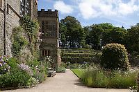 Summer borders in front of Haddon Hall looking up to the Upper Garden