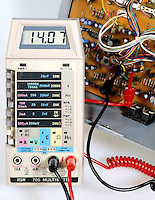 DIGITAL MULTIMETER<br /> (Variations Available)<br /> Used as Voltmeter<br /> Testing resistor on stereo amplifier board. Reads 281,400 ohms.
