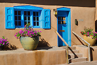 Colorful adobe house with flowers on Canyon Road. Santa Fe, New Mexico