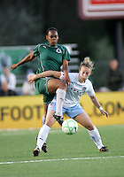 Kia McNeil (left) gets to the ball ahead of Ella Masar (right)..Saint Louis Athletica were defeated 1-0 by Chicago Red Stars in which was both teams inaugural game, played at Korte Stadium, Edwardsville, Illinois  on April 4, 2009.
