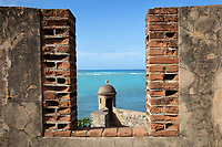Lookout gap between crenelations at the Fortaleza San Felipe, or El Morro de San Felipe, a defensive fortress built 1564-77 to protect Puerto Plata from pirates, in Puerto Plata province, Dominican Republic, in the Caribbean. In 1983 the Museo de la Fortaleza San Felipe was opened here, containing military artefacts from the fort's history. Picture by Manuel Cohen