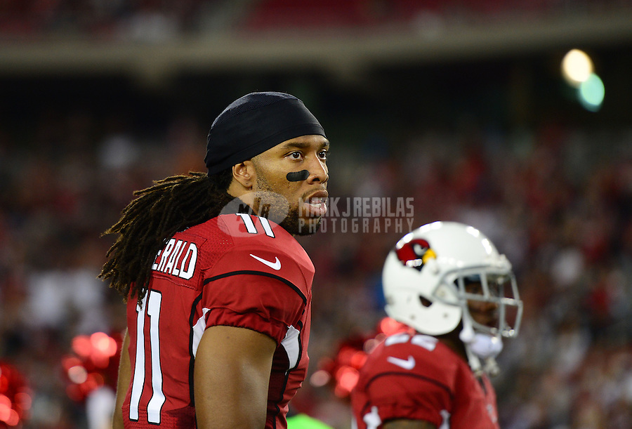 Aug. 17, 2012; Glendale, AZ, USA; Arizona Cardinals wide receiver Larry Fitzgerald prior to the game against the Oakland Raiders during a preseason game at University of Phoenix Stadium. The Cardinals defeated the Raiders 31-27. Mandatory Credit: Mark J. Rebilas-
