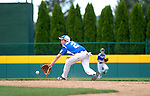 Second baseman tries to make the play at a Little League game.
