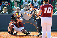 11 February 2012:  FIU's Jessy Alfonso (8) hits as the University of Massachusetts Minutewomen defeated the FIU Golden Panthers, 3-1, as part of the COMBAT Classic Tournament at the FIU Softball Complex in Miami, Florida.
