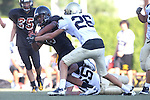 Beverly Hills, CA 09/23/11 - Jason Burr (Peninsula #26), A.J. Hezlep (Peninsula #55) and unknown Beverly Hills player(s) in action during the Peninsula-Beverly Hills frosh football game at Beverly Hills High School.