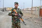 Ameer Naser, 20, is a member of the Nineveh Plain Protection Units, a Christian militia that patrols the town of Qaraqosh, a Christian community that was occupied by the Islamic State in 2014 and liberated by the Iraqi army in late 2016. Residents have yet to return, citing continued insecurity.